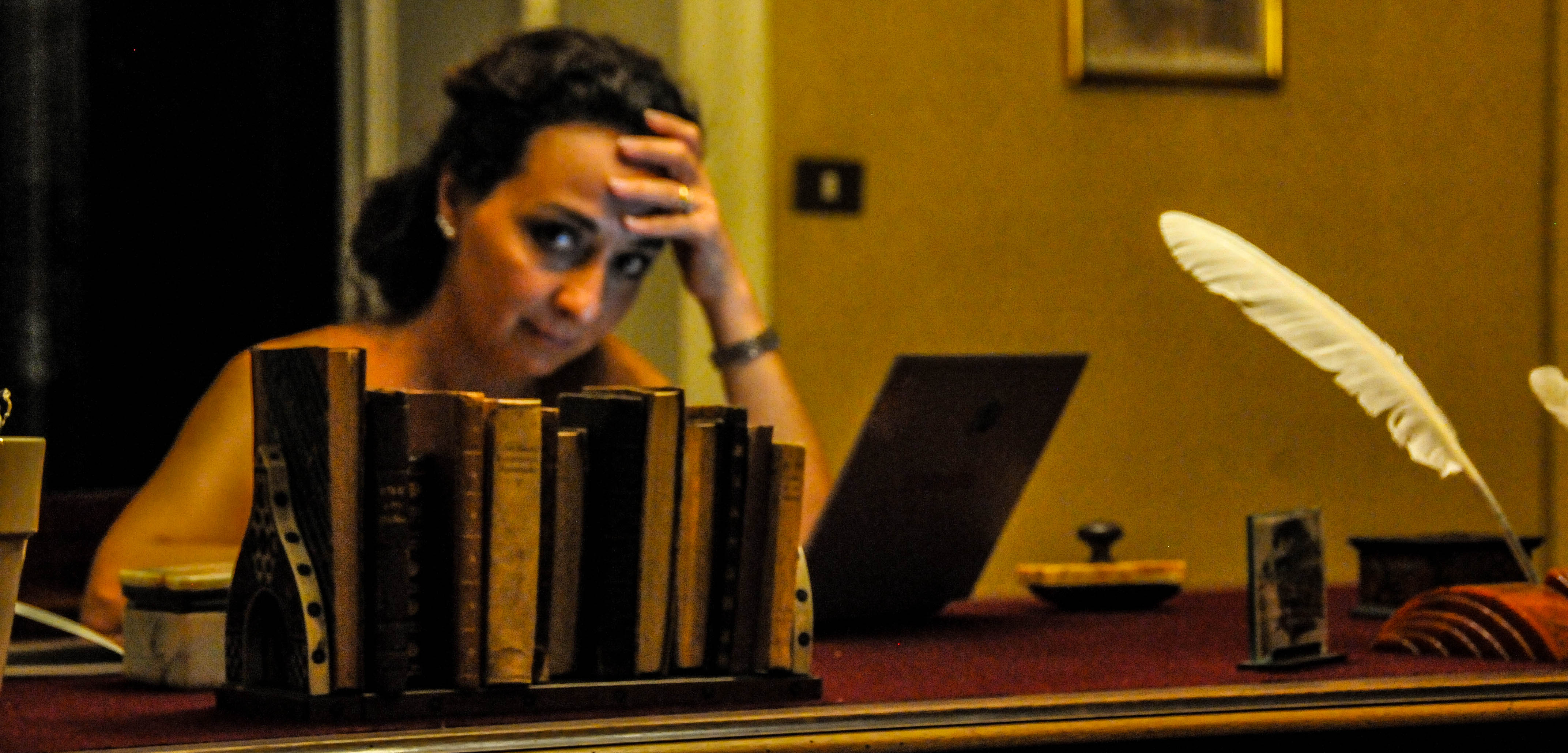 Giada Trebeschi with books and feather